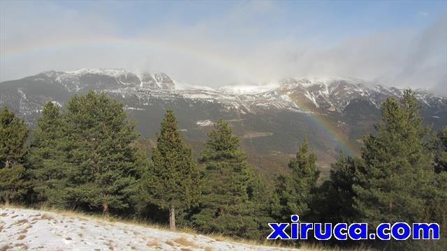 Arco iris delante de la Tosa d'Alp y el Coll de Pal